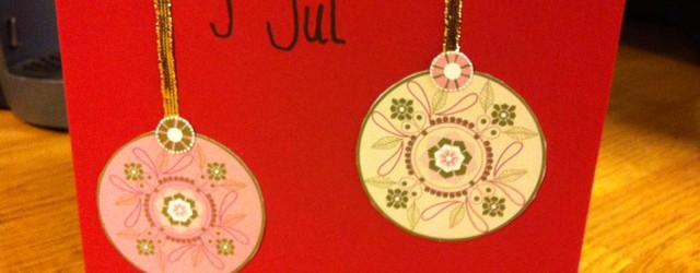 Julkort med julgranskulor